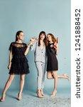 three women celebrate the... | Shutterstock . vector #1241888452