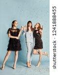 three women celebrate the... | Shutterstock . vector #1241888455