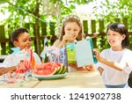 multicultural group of kids is...   Shutterstock . vector #1241902738