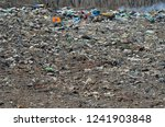 a landscape on scrap heap. | Shutterstock . vector #1241903848