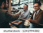 businessmen socializing at the... | Shutterstock . vector #1241994382