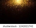 gold falling sparkles on black... | Shutterstock . vector #1242021742