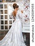 elegant bride in a gorgeous... | Shutterstock . vector #1242039355