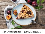 piece of plum cake on a plate... | Shutterstock . vector #1242050338