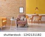 modern living room yellow sofa... | Shutterstock . vector #1242131182