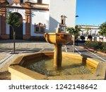 a fountain in rociana de...   Shutterstock . vector #1242148642