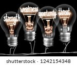 photo of light bulbs with... | Shutterstock . vector #1242154348
