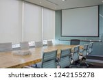 meeting room with white curtain ... | Shutterstock . vector #1242155278