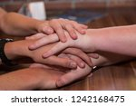 several hands agree on each... | Shutterstock . vector #1242168475