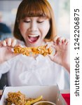attractive asian woman eating... | Shutterstock . vector #1242206875