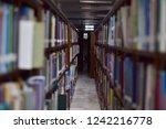 close up of a bookshelf in... | Shutterstock . vector #1242216778