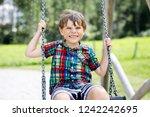 funny kid boy having fun with...   Shutterstock . vector #1242242695