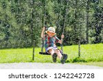 funny kid boy having fun with... | Shutterstock . vector #1242242728