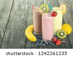 fruit smoothies with straws ... | Shutterstock . vector #1242261235