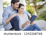 relaxed young couple sitting... | Shutterstock . vector #1242268768