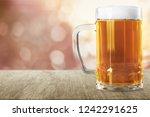 mug of cold beer with foam ... | Shutterstock . vector #1242291625