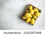 lemons with green leaves in box ... | Shutterstock . vector #1242307648