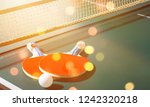 table tennis rackets and ball... | Shutterstock . vector #1242320218