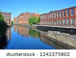 Pawtucket Canal and historic mill buildings in Lowell National Historic Park in downtown Lowell, Massachusetts, USA.