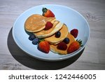 fluffy japanese pancakes with... | Shutterstock . vector #1242446005