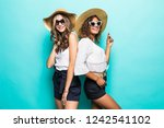 two vacation girls with... | Shutterstock . vector #1242541102