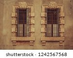 two ancient old windows on... | Shutterstock . vector #1242567568
