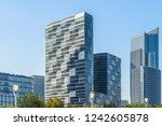 modern office building against... | Shutterstock . vector #1242605878