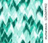 ikat pattern abstract... | Shutterstock . vector #1242659902