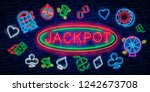 jackpot neon sign. slot machine ... | Shutterstock .eps vector #1242673708