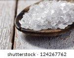 Salt Spoon on a white table - stock photo