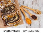 poppy seeds cake with... | Shutterstock . vector #1242687232