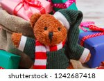 teddy bear and wrapped colorful ... | Shutterstock . vector #1242687418