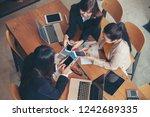 group of teamwork using smart... | Shutterstock . vector #1242689335