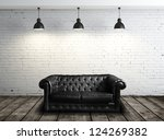 Leather Sofa In Brick Room And...
