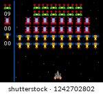 cosmic invaders game. pixel...   Shutterstock .eps vector #1242702802