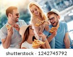 close up of four young cheerful ... | Shutterstock . vector #1242745792