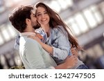 happy young loving couple... | Shutterstock . vector #1242747505