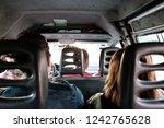 minivan passengers share a ride ... | Shutterstock . vector #1242765628