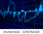 stock market trading graph and... | Shutterstock . vector #1242766165