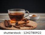 aromatic hot cinnamon tea on... | Shutterstock . vector #1242780922