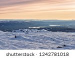 dawn in the winter in the... | Shutterstock . vector #1242781018
