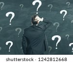 back view of young businessman... | Shutterstock . vector #1242812668