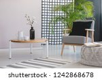 flowers on wooden table next to ... | Shutterstock . vector #1242868678