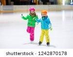 child skating on indoor ice... | Shutterstock . vector #1242870178