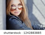 beautiful woman in the city  | Shutterstock . vector #1242883885