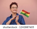bolivia flag. woman holding... | Shutterstock . vector #1242887605