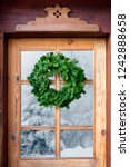 christmas wreath on a rustic... | Shutterstock . vector #1242888658