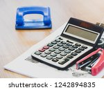 office equipment calculator on... | Shutterstock . vector #1242894835