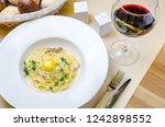 pasta carbonara on white plate... | Shutterstock . vector #1242898552