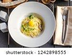 pasta carbonara on white plate... | Shutterstock . vector #1242898555